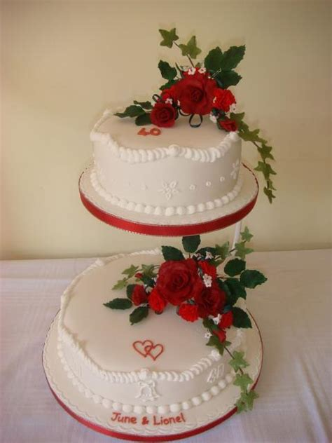 wedding anniversary cake decorations with red flowers